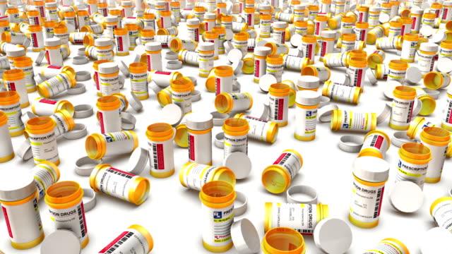 high angle arc pull back revealing endless empty pill bottles - amfetamin pills bildbanksvideor och videomaterial från bakom kulisserna
