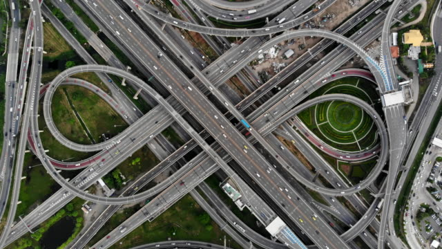 High angle looking top down view of complicate road and expressway intersection in Bangkok city of Thailand. Shot by drone can use for transportation or abstract concept. High angle looking top down view of complicate road and expressway intersection in Bangkok city of Thailand. Shot by drone can use for transportation or abstract concept. complexity stock videos & royalty-free footage