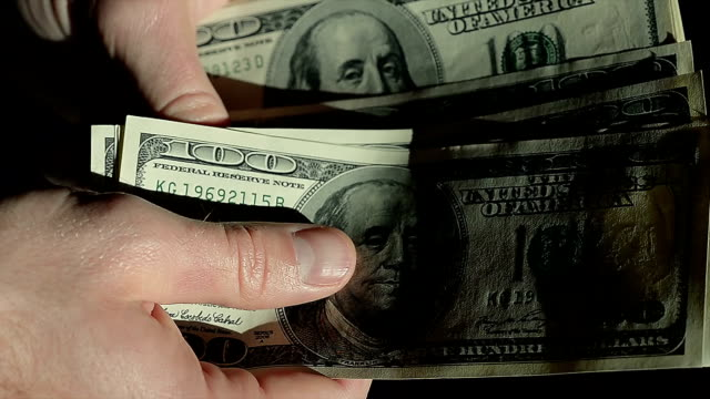 High Angle Male Hands Count Hundred Dollar Bills video
