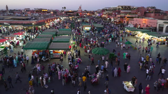 high angle night shot of market stalls at the jemaa el-fnaa market in marrakesh - souk video stock e b–roll