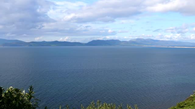 Bидео High angle panoramic view of Irish coastline