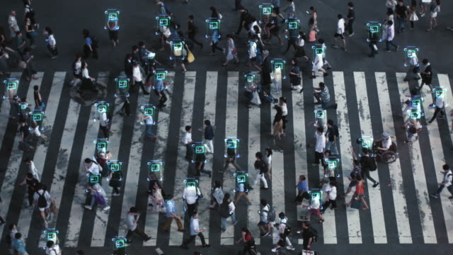 high angle shot of a crowded pedestrian crossing in big city. augmented reality shows visual representation of face recognition technology. artificial intelligence learning process. - ai stock videos & royalty-free footage