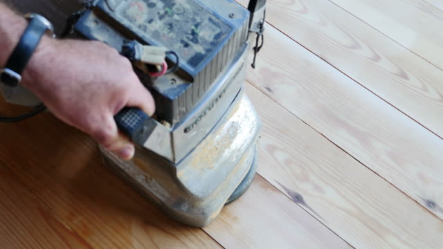 a high angle shot of a man sanding a parquet - levigatrice video stock e b–roll