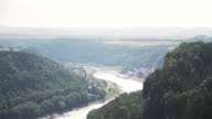 istock High angle tilt view from Basteiaussicht, beautiful viewpoint on mountain peak including rock top castle ruin, Neurathen Castle to see Stadt Wehlen, small Village around Kurort Rathen railway station on a curve of Elbe river in Germany in a weekend. 1286475258