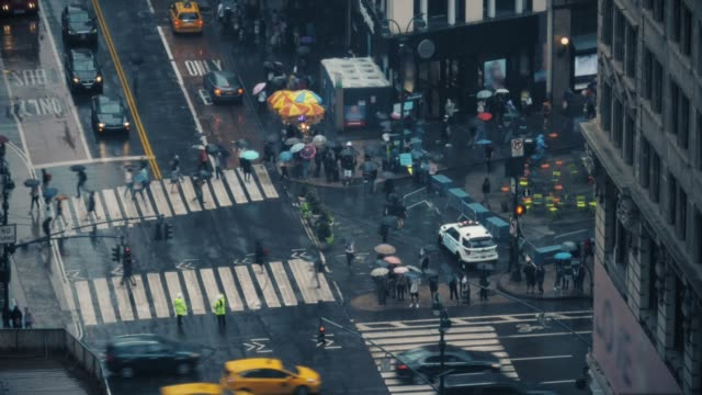 High Angle Timelapse View of Manhattan Pedestrians in the Rain video