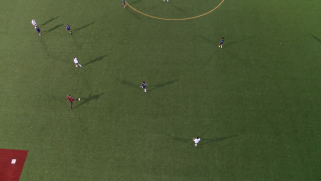 high angle view of a soccer team passing ball up the field - competizione video stock e b–roll