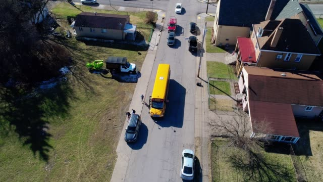 high angle view of children and school bus - school buses stock videos and b-roll footage