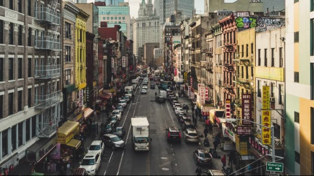 T/L PAN High angle view of Chinatown from Manhattan bridge Rooftop Chinatown view downtown NYC manhattan bridge stock videos & royalty-free footage