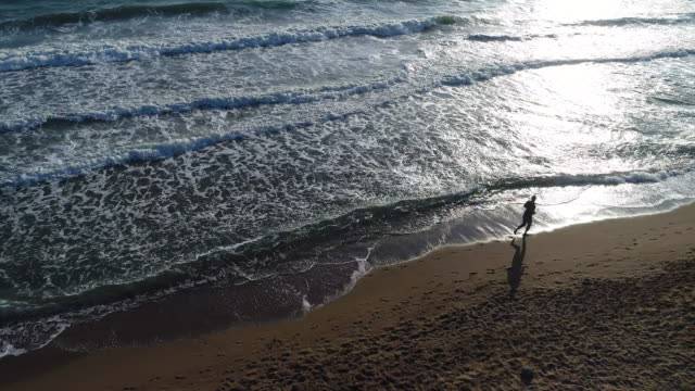 High angle view of man jogging on the beach video