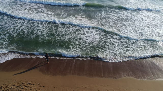 High angle view of man walking on the beach