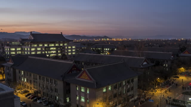 T/L WS HA ZO High Angle View of Peking University, Dusk to Night Transition / Beijing, China video