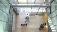 istock High angle view of people and healthcare professionals walking in and out of the hospital 1152080347