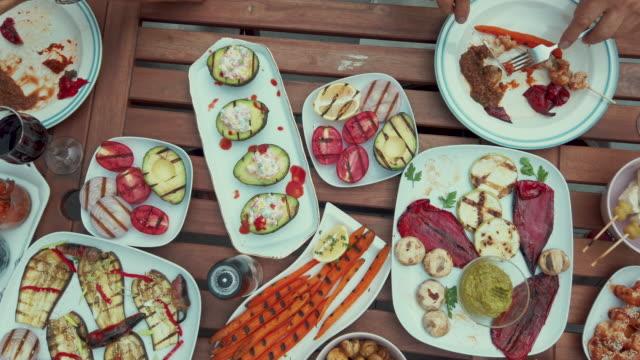 high angle view of people eating vegan food - vegetarian stock videos & royalty-free footage