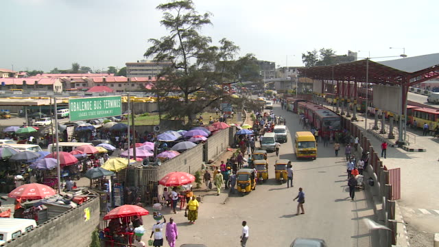 high angle view over bus station in lagos, nigeria - nigeria video stock e b–roll