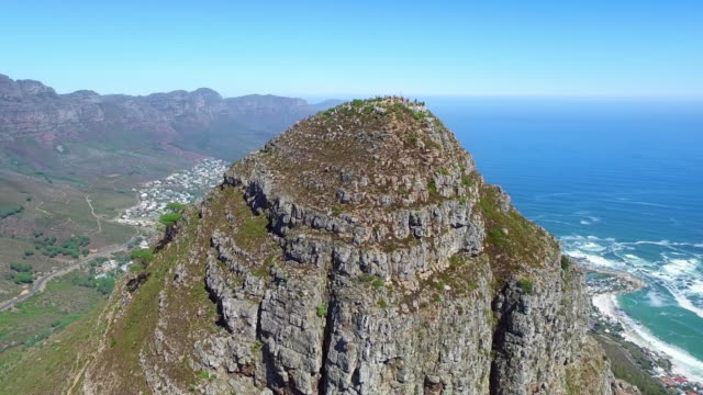 High atop Lions Head Aerial drone footage of Lion's Head and Camps Bay in Cape Town, South Africa western cape province stock videos & royalty-free footage