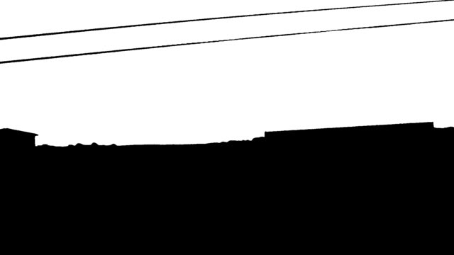 High contrast silhouette of power-lines from moving car video