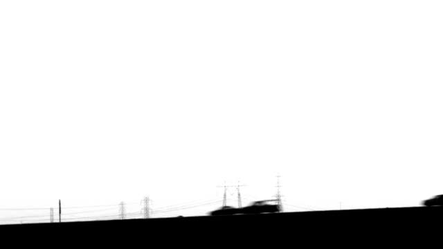 High Contrast Vehicles Traveling Across Grade video