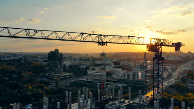High crane on sunset background. High crane on sunset background. 4K cement stock videos & royalty-free footage
