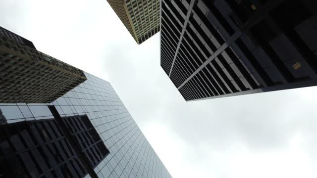 high elevation view of skyscrapersin downtown chicago - guardare in su video stock e b–roll