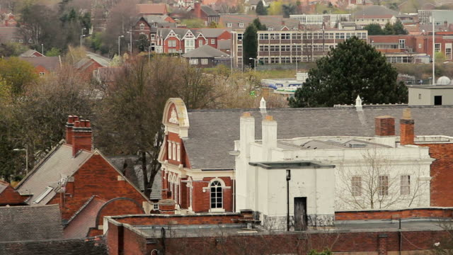 a high exterior shot of redbrick tamworth rooftops - центральный район стоковые видео и кадры b-roll
