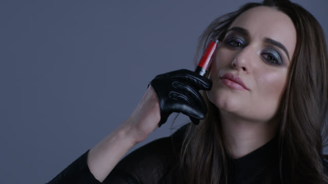 High fashion model holds red lipstick in her hand, playing with it. Fashion video. High fashion model holds red lipstick in her hand, playing with it. Fashion video. Slow Motion. 4K 30fps ProRes 4444 lip liner stock videos & royalty-free footage