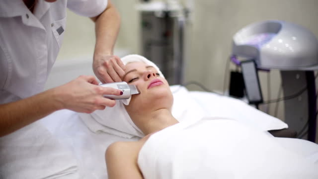 High frequency skin treatment in female face in spa video