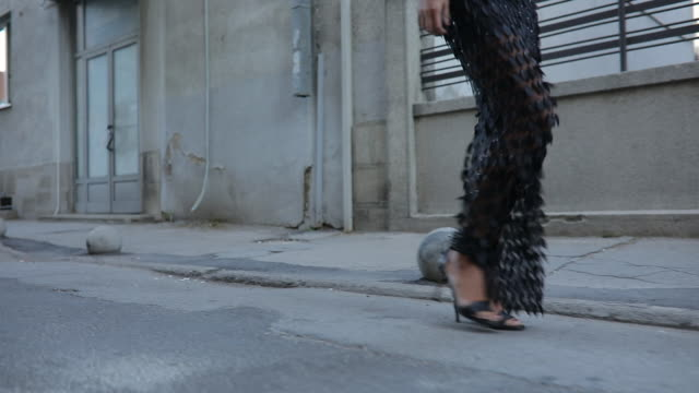 High heels on the street High heels and long black dress on the street urban fashion stock videos & royalty-free footage