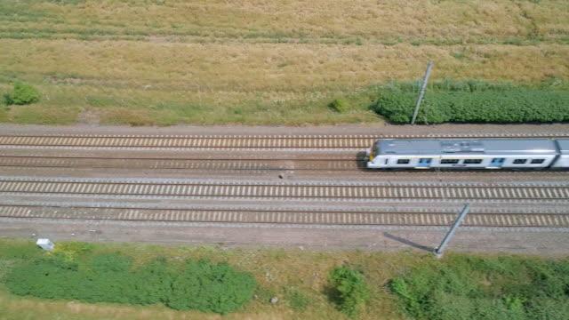high level view of a commuter train - intercity filmów i materiałów b-roll