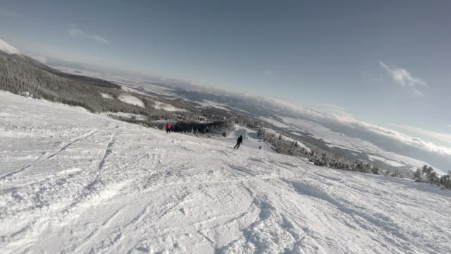 4K High mountain skiing resort: skier goes down the hill video