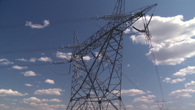 High power electrical lines against a beautiful sky video