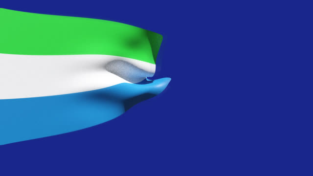 high resolution video of a 3d rendered sierra leone flag, moving on a blue background. - sierra leone video stock e b–roll