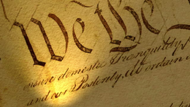 High resolution video with focus on a portion of the US Constitution text.