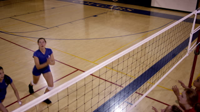 High School Girls Volleyball A high school girls volleyball team playing in uniforms spiking the ball. volleyball sport stock videos & royalty-free footage