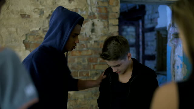 vídeos de stock e filmes b-roll de high school student bullying junior, humiliation, aggression against weaker - ameaça