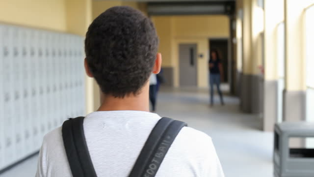 High School Student Walking Along Hallway video