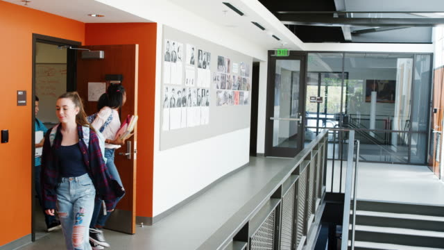 High School Students And Staff Leaving Classroom At The End Of Lesson