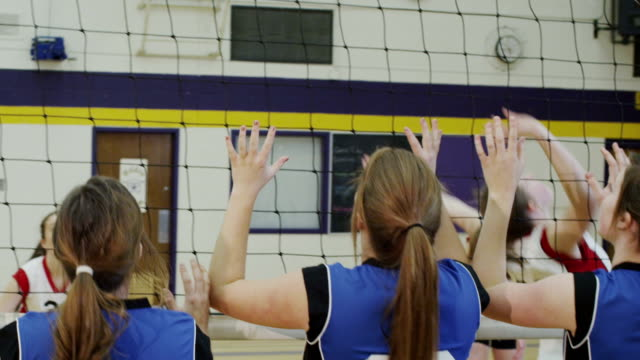 High school volleyball game Women's high school volleyball. volleyball sport stock videos & royalty-free footage