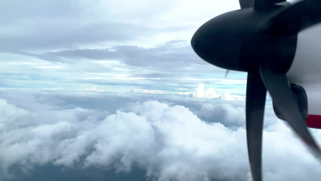 High Speed Propeller Aircraft Jet Engine in Motion Flying, Commercial Airliner, Aviation - 4k footage from a commercial airliner passenger window propeller airplane stock videos & royalty-free footage