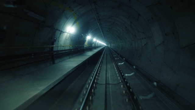 High speed ride of a train in a straight underground tunnel in the modern city video