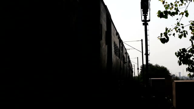 High Speed train entering in to the station High speed train running on railroad track located in Haryana, India during sunset in summer season. haryana stock videos & royalty-free footage