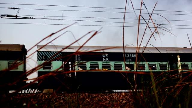 high speed train entering in to the station - intercity filmów i materiałów b-roll