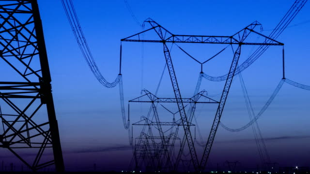 High Voltage Electric Transmission Tower Energy Pylon. Sunset. Heat haze. Timelapse. video