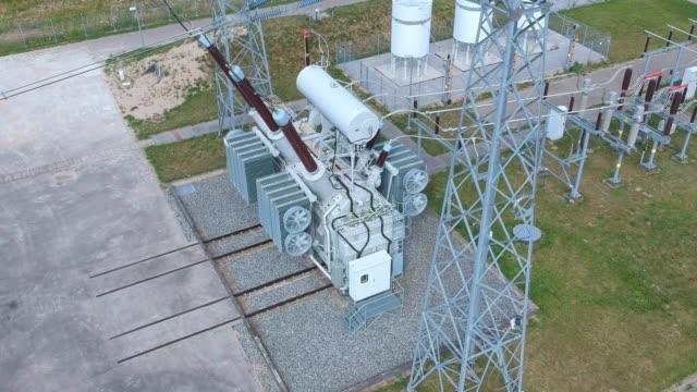 high voltage energy transformer station, aerial view - sottostazione elettrica video stock e b–roll