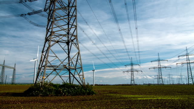 High Voltage Power Line Long distance tracking shot of electricity pylons.  power line stock videos & royalty-free footage