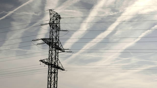 High voltage pylon, metal pole voltage, industrial building, power line pylon video
