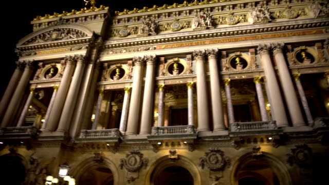 High white columns of illuminated Opera building in Paris, ancient architecture video