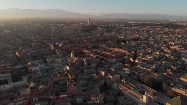 High wide drone shot of a Moroccan city at sunset
