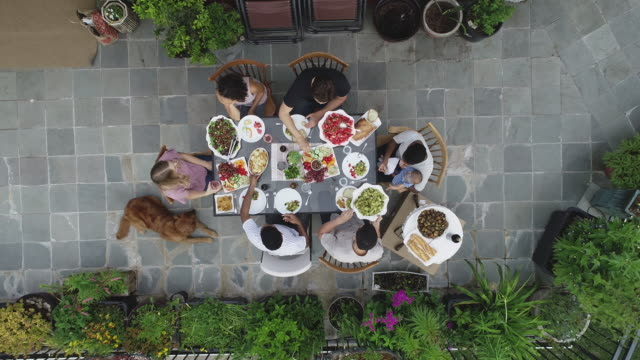 High-angle view of friends gathered for dinner