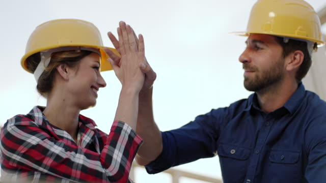 High-five! Female architect celebratory hit the palm of foreman hand video