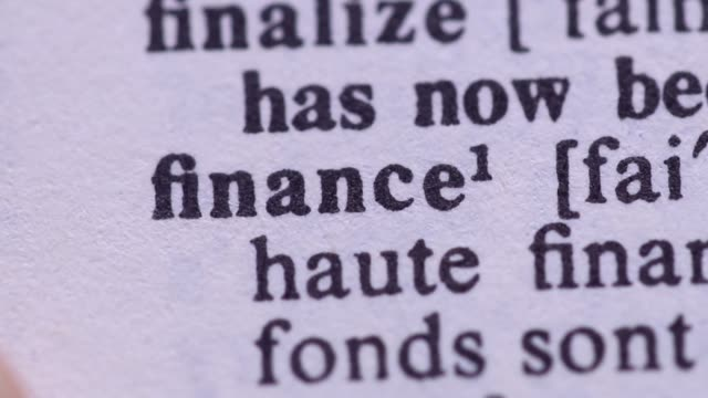 Highlighting the word FINANCE definition. Signaling the meaning of financial knowledge video